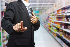 Business man pushing in supermarket in blurry Stock Photos