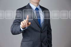 Business Man pushing on a touch screen Royalty Free Stock Photos
