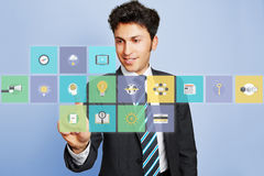 Business man pushing virtual brain icon Royalty Free Stock Photo