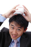 Business man put baseball on his head Royalty Free Stock Photo