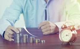 Business man put money on pile of coin Royalty Free Stock Images