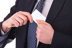 Businessman putting blank card in his pocket. Stock Photo