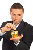 Business man putting coin in piggy bank Stock Image