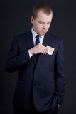 Business man putting euro banknote into suit pocket Stock Photos