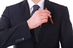 Businessman putting a pen in his pocket. Business man putting a pen in his pocket stock photos