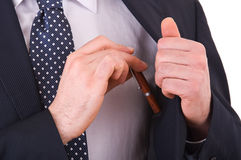 Businessman putting a pen in his pocket. Stock Image