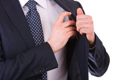 Businessman putting a pen in his pocket. Royalty Free Stock Photo