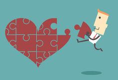Business man putting together jigsaw heart image vector file ill Stock Photo