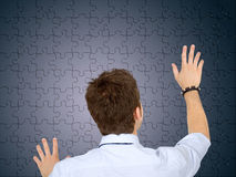 Business man with a puzzle Royalty Free Stock Photography