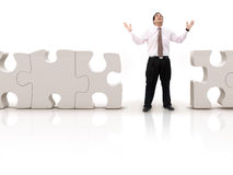 Business man with a puzzle Stock Photos