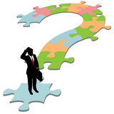 Business man question mark puzzle solution Royalty Free Stock Images