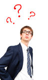 Business  man with question marks. Isolated business man looking up to the question marks Royalty Free Stock Photo