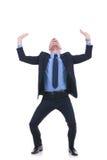 Business man raises something imaginary Royalty Free Stock Photo