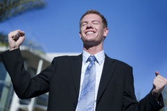 Business man raising his arm royalty free stock images