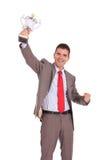 Business man raising trophy Stock Image