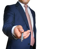 Business - Man reaching ballpoint pen. Businessman in blue suit and tie, reaching ballpoint pen towards you royalty free stock images