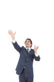 Business man reaching to grab something from above his head. Man in suit taking something up with hand with empty copy space form above Stock Image