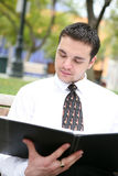 Business man reading Royalty Free Stock Images