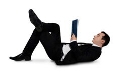 Business man reading book Stock Photography
