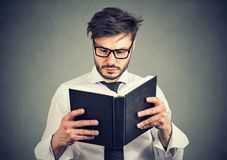 Business man reading a book royalty free stock photography