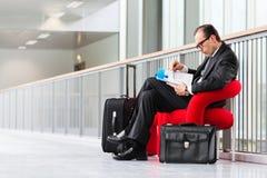 Business man reading catalog at exhibition lobby Royalty Free Stock Photos