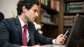 Business man reading a document Stock Photo