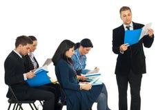 Business Man Reading Folder At Seminar Royalty Free Stock Image