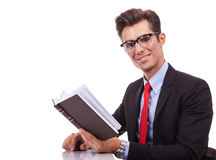 Business man reading an interesting book Stock Photo