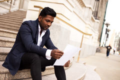 Business man reading letter Royalty Free Stock Images