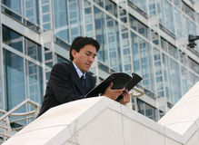 Business man reading mag - andres Royalty Free Stock Image