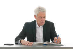 Business man reading a manual Stock Photos