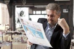 Business man reading a newspape Stock Photo