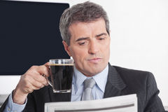 Business man reading newspaper Stock Photo