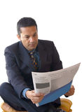 Business man reading newspaper - je Royalty Free Stock Photography