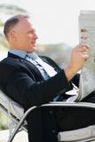 Business man reading a newspaper outdoors Stock Photo