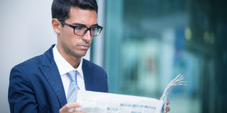 Business man reading the newspaper Stock Photography