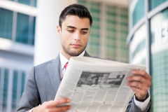 Business man reading a newspaper Stock Image