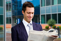 Business man reading a newspaper Stock Photo
