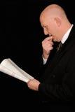 Business man reading paperwork Royalty Free Stock Photos