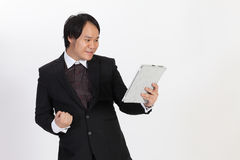business man reading something on his tablet and show w Stock Photo