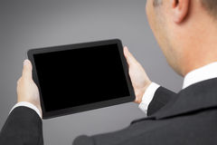 Business man reading tablet pc Stock Photo