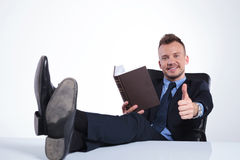 Business man reads with feet on desk Royalty Free Stock Photography