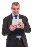 Business man reads from tablet Stock Photo