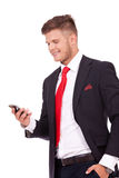 Business man reads text on phone Royalty Free Stock Photo