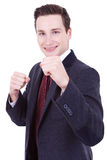 Business man ready for a fight. Business man in suit and tie with his fists raised ready for a fight Royalty Free Stock Image