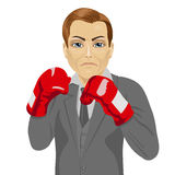Business man ready to fight with boxing gloves. Over white background Stock Photography