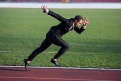 Business man ready to sprint Stock Photo