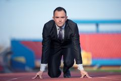 Business man ready to sprint Stock Images