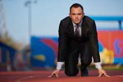 Business man ready to sprint Royalty Free Stock Image