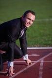 Business man ready to sprint Royalty Free Stock Photos